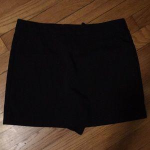 Skirt/short combo.